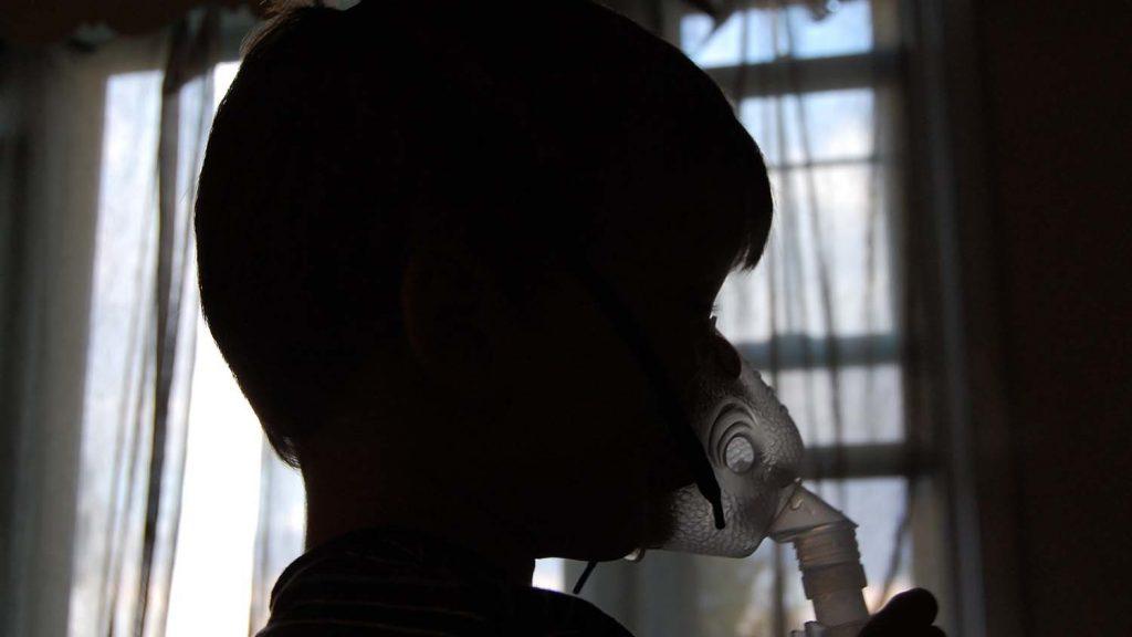 child using breathing device