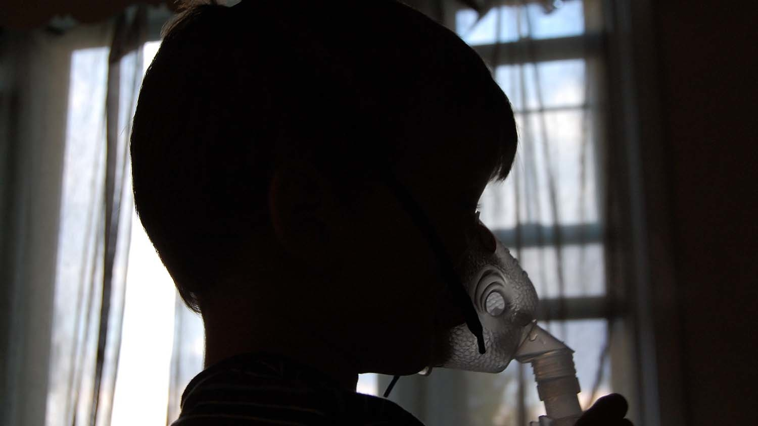 child using breathing device