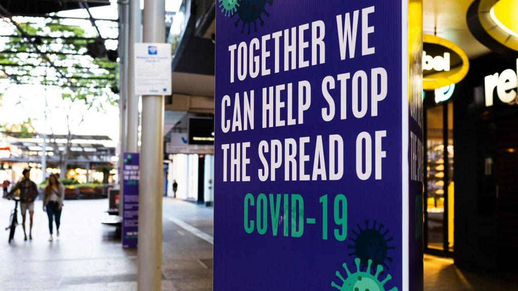 """sign reading """"together we can help stop the spread of covid-19"""""""