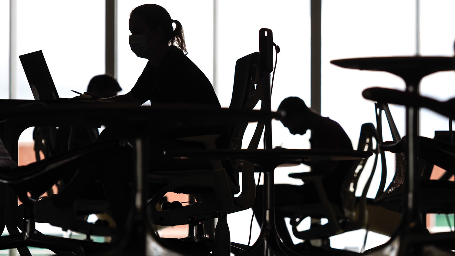 masked students in silhouette