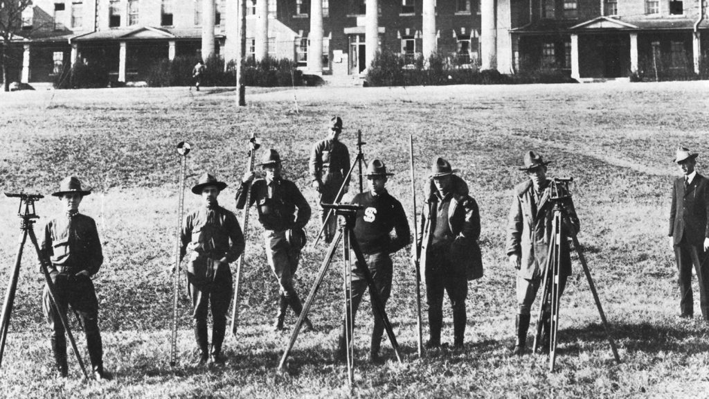 black and white photo of early 20th century survey squad
