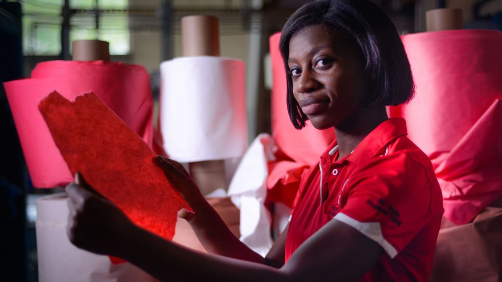 Student Nelessa Lewis inspects paper at The Robertson Pulp and Paper Laboratory.