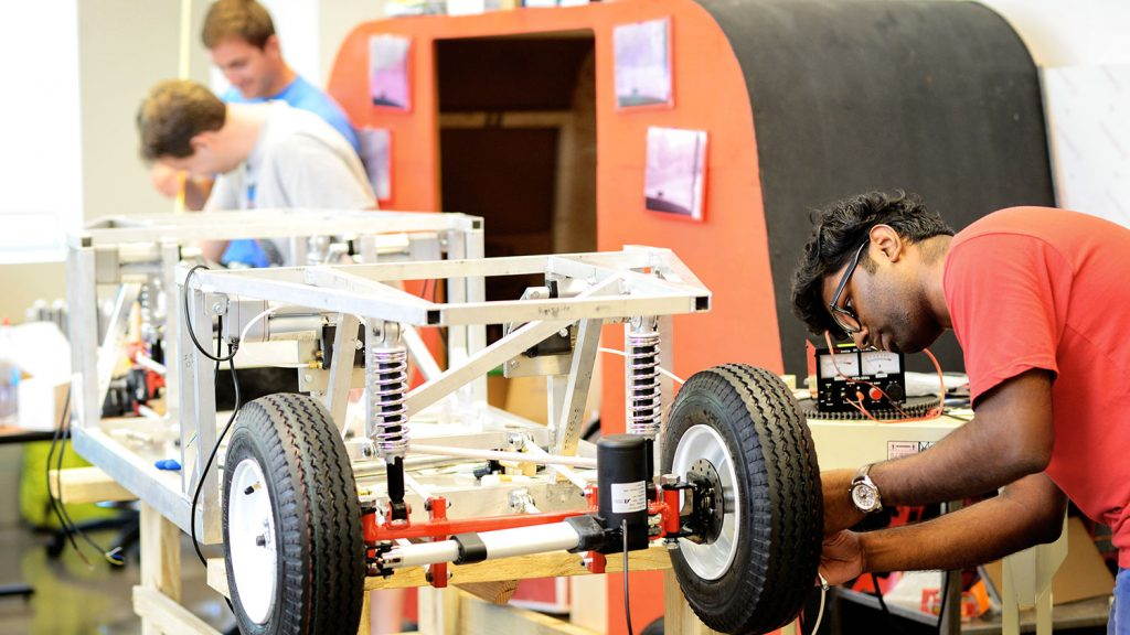 Students work on an EcoPRT car. The EcoPRT (ecological personal rapid transit) is an ultra-light and low-cost transit system featuring autonomous two-person cars that would drive on a guideway railing system.