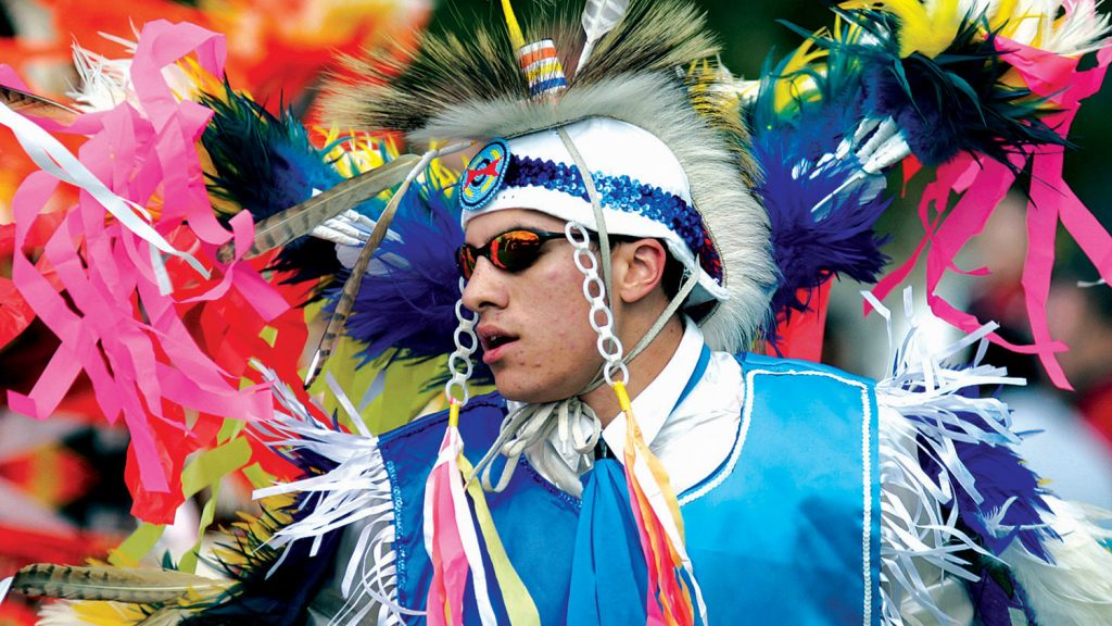 Engineering student dances in the men's fancy during a Native American powwow at NCState.