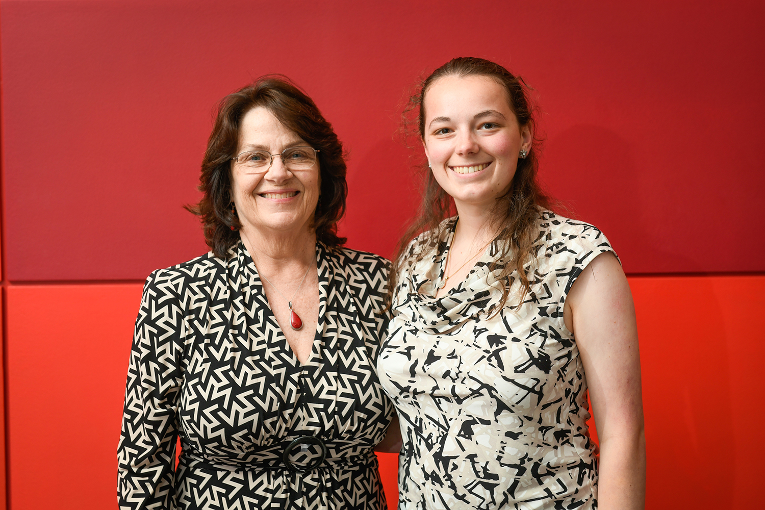 Suzanne Gordon, president of the NCState Engineering Board of Directors, meets with a scholarship recipient at the 2019 Engineering Annual Endowment Dinner.