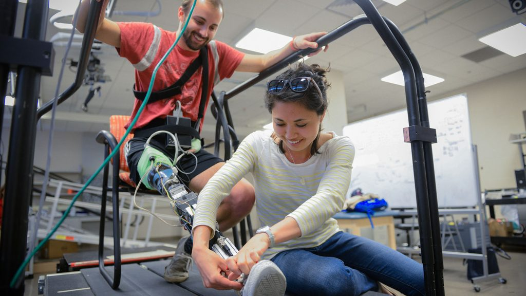 Andy Brandt (right) works with lab volunteer and MAE student Charles Humphries
