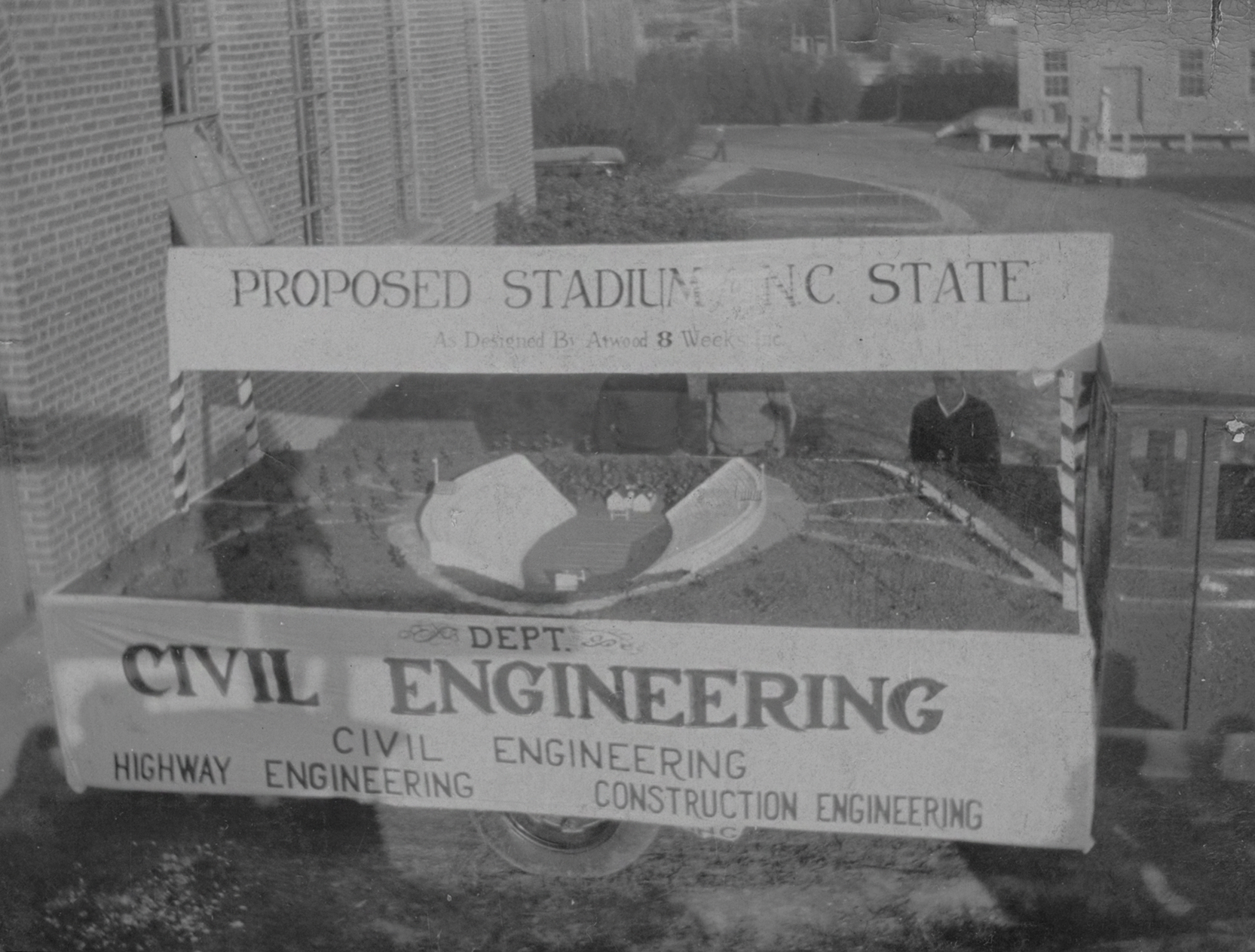 1931 image of truck with model of then proposed NCState stadium on truck bed